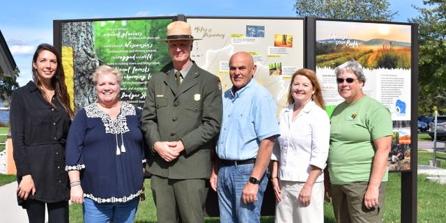 A dedication of a new Ice Age Trail exhibit at the Merrimac Ferry Wayside Park included Alaina Dedo, Ice Age Trail Alliance, Cross Plains; Alderperson Ann Groves-Lloyd, Lodi; National Park Service Superintendent Eric Gabriel, Madison; State Representative Dave Considine, Baraboo; Ice Age Trail Chapter Volunteers Amy Onofrey, Lodi; and Debby Capener, Portage.