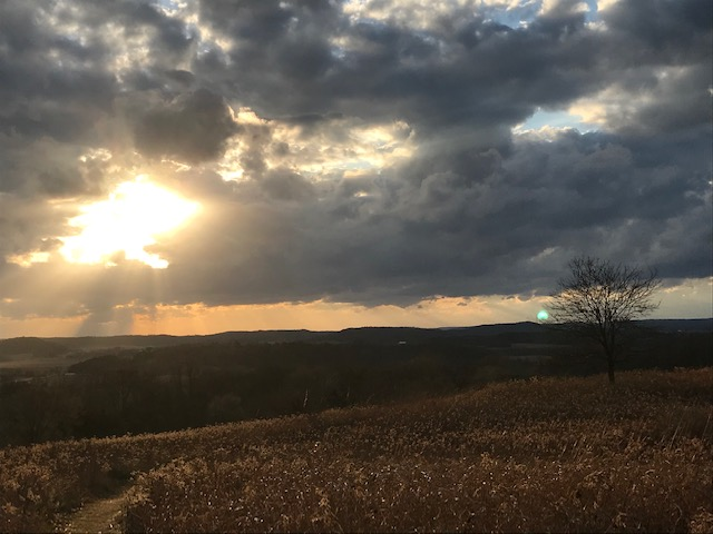Sun breaking through the clouds along the Ice Age Trail