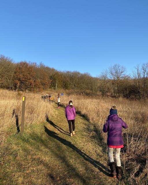 Socially distanced hiking club members